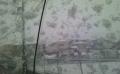 ビニール傘に落ちる雪