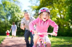 stock-photo-16461455-learning-to-ride-a-bike.jpg