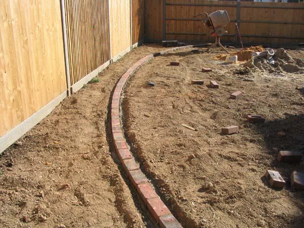 Finish off your landscape with elegant brick edging tufudy - Landscaping bricks for edging ...
