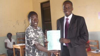 Okwera Geoffrey receiving Report card