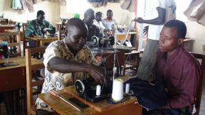A student attend to a teacher in Tailoring class