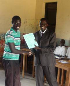 Ojok Patrick recieves his Report card
