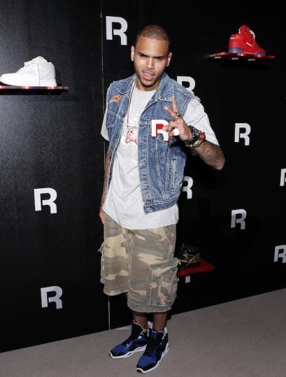 Chris-Brown-Reebok-Customized-jean-vest-jacket-Camo-shorts-Kamikaze-sneakers-11.jpg